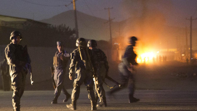 Afghan police arrive to secure the area after a car bomb detonated outside an ISAF civilian personnel compound in Kabul, Afghanistan, Friday, Oct 18, 2013. Police said the assault started at dusk when a car exploded near the gate of a compound, housing contractors from various countries, European diplomatic personnel and United Nations employees. (AP Photo/Anja Niedringhaus)