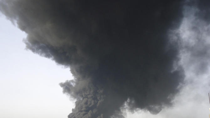 FILE - This Wednesday Feb. 15, 2012 file photo released by the Syrian official news agency SANA, shows black smoke rising from an oil pipeline, in Baba Amr neighborhood in Homs province, Syria. Syria's vital oil industry is breaking down as rebels capture many of the country's oil fields, with wells aflame and looters scooping up crude, depriving the government of much needed cash and fuel for its war machine against the uprising.(AP Photo/SANA, File)