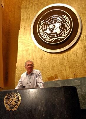 Director Sydney Pollack behind the podium of the U.N. General Assembly filming Universal Pictures' The Interpreter