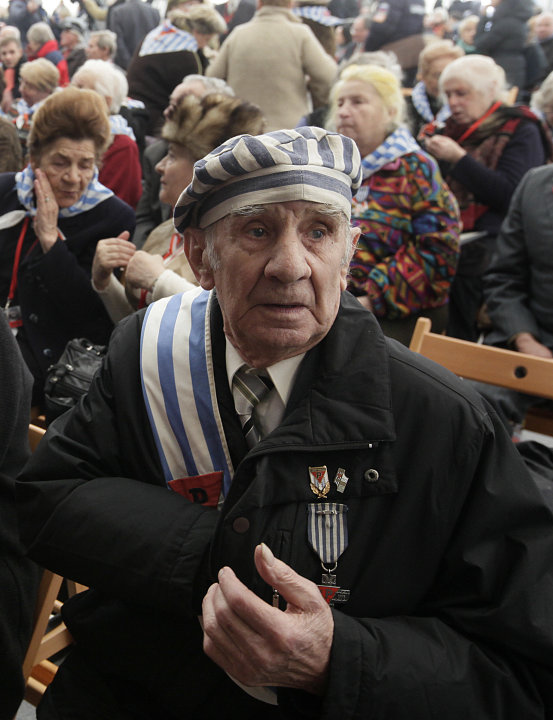 Former prisoner Miroslaw Celka, 89, attends a ceremony at  the Auschwitz concentration camp  in Oswiecim, Poland, Sunday, Jan. 27, 2013,  marking the 68th anniversary of the liberation of Auschwitz by