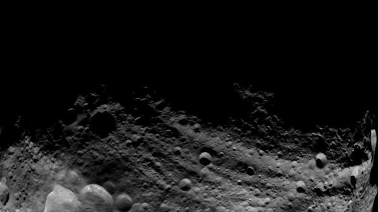 In this image released by NASA/JPL on Thursday July 28,2011 shows an image of the dark side of Vesta asteroid captured by NASA'S Dawn spacecraft on July 23, 2011, and taken from a distance of about 3,200 miles (5,200 kilometers) away from the giant asteroid. Scientists are busy poring through images of  Vesta, the first time it has been photographed up close. On July 15,  the Dawn spacecraft slipped into orbit around the 330-mile-wide rocky body and began beaming back images. (AP Photo/NASA/JPL)