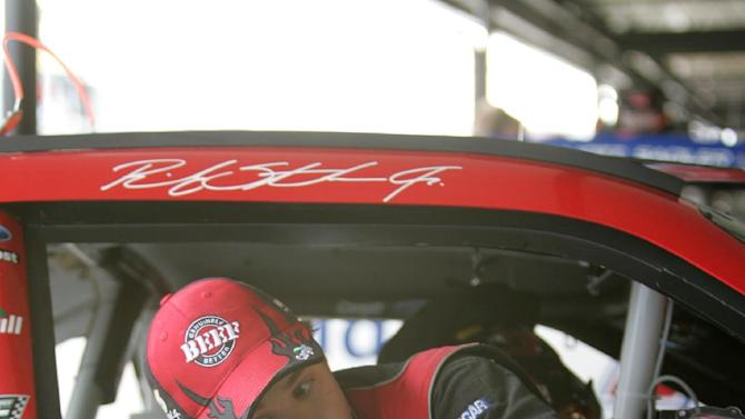 NASCAR driver Ricky Stenhouse Jr. climbs out of his car after hitting the wall at Darlington Raceway during practice for the Nationwide Series auto race, Friday, May 11, 2012 in Darlington, S.C. (AP Photo/Mary Ann Chastain)