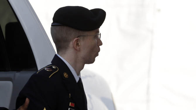 Army Pfc. Bradley Manning is escorted into a courthouse in Fort Meade, Md., Tuesday, Aug. 20, 2013, before a hearing in his court martial. A prosecutor recommended in closing arguments Monday that Manning should spend 60 years in prison for giving classified material to WikiLeaks. A U.S. military judge was set to deliberate the sentence of Manning on Tuesday for the largest leak of classified information in the country's history. (AP Photo/Patrick Semansky)