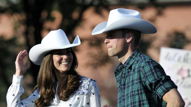 Prince William and Kate, the Duke and Duchess of Cambridge, watch a bull riding demonstration during the Calgary Stampede on Thursday, July 7, 2011 in Calgary, Alberta. (AP Photo/The Canadian Press, Nathan Denette)