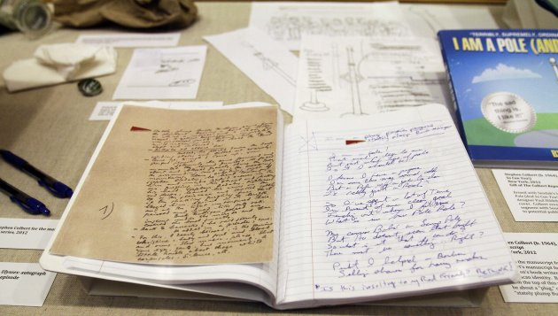 A display of the manuscript of James Joyce&#39;s &quot;Ulysses&quot;, left, compared to the talk show host Stephen Colbert&#39;s manuscript from &quot;I Am A Pole (And So Can You!), at the Rosenbach Museum & Library Monday, July 30, 2012, in Philadelphia. A new exhibit pairs priceless material by James Joyce and Maurice Sendak with items Colbert used to create his childrens book. (AP Photo/Brynn Anderson)