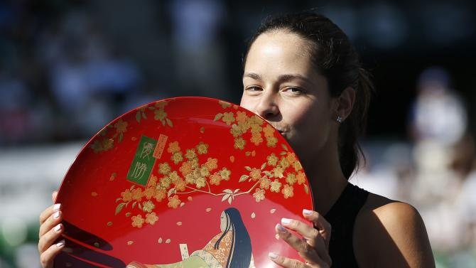Ivanovic of Serbia kisses her trophy after defeating Wozniacki of Denmark at their Pan Pacific Open women's singles final tennis match in Tokyo