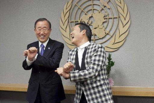South Korean rapper Psy, right, teaches UN leader Ban Ki-moon some of his famous dance routines