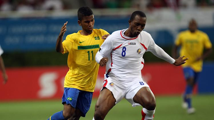 Costa Rica's Jorge Davis, right, drives the ball followed by Brazil's Alcides Farias during a men's soccer match at the Pan American Games in Guadalajara, Mexico, Sunday, Oct. 23, 2011. (AP Photo/Juan Karita)