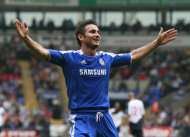 Chelsea's Frank Lampard celebrates after scoring his third goal against Bolton Wanderers during their English Premier League soccer match in Bolton, England, Sunday Oct. 2, 2011. (AP Photo/Tim Hales)