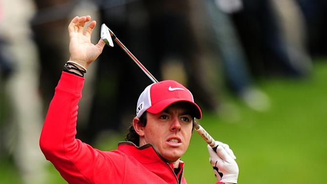 Northern Ireland's Rory McIlroy reacts to a wayward shot during the first day of the BMW PGA Championship at the Wentworth Club, Virginia Water, England, Thursday, May 23, 2013. (AP Photo / Adam Davy, PA )  UNITED KINGDOM OUT  PHOTOGRAPH