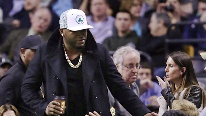 Boston Red Sox designated hitter David Ortiz is greeted by fans during half time of a basketball game between the Boston Celtics and Milwaukee Bucks in Boston, Friday, Nov. 2, 2012. (AP Photo/Charles Krupa)