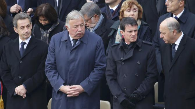 Former French president Sarkozy, President of the French Senate Larcher, Interior Minister Valls and Foreign Affairs Minister Fabius attend a ceremony to pay a national homage to the victims of the Paris attacks at Les Invalides monument in Paris