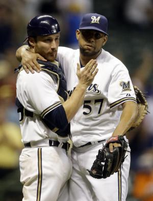 Milwaukee Brewers catcher Jonathan Lucroy, left, congratulates relief pitcher Francisco Rodriguez after picking up the save after a baseball game against the Miami Marlins, Friday, July 19, 2013, in Milwaukee. The Brewers won 2-0. (AP Photo/Morry Gash)