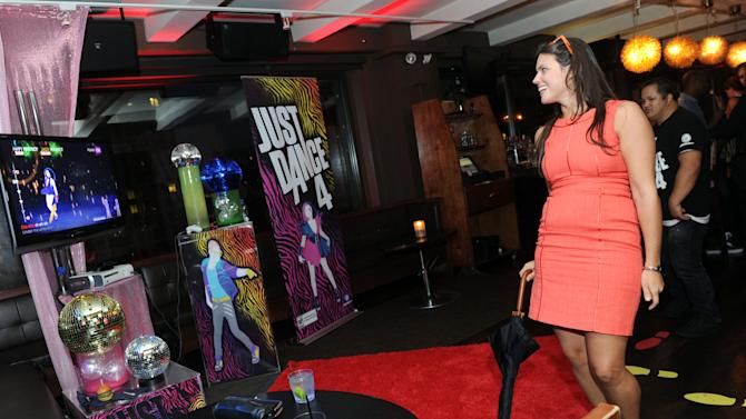 COMMERCIAL IMAGE - A guest enjoys Just Dance 4 on Kinect for Xbox 360 at Ubisoft's NYC Dance Party showcasing their holiday line-up of dance video games, Tuesday, Aug. 21, 2012, at New York's Empire Hotel. (Photo by Diane Bondareff/Invision for Ubisoft/AP Images)