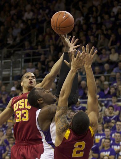 Huskies rout undermanned USC 69-41
