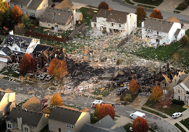 This aerial file photo from Nov. 11, 2012,  shows the two homes that were leveled and the numerous neighboring homes that were damaged from a massive explosion that sparked a huge fire and killed two