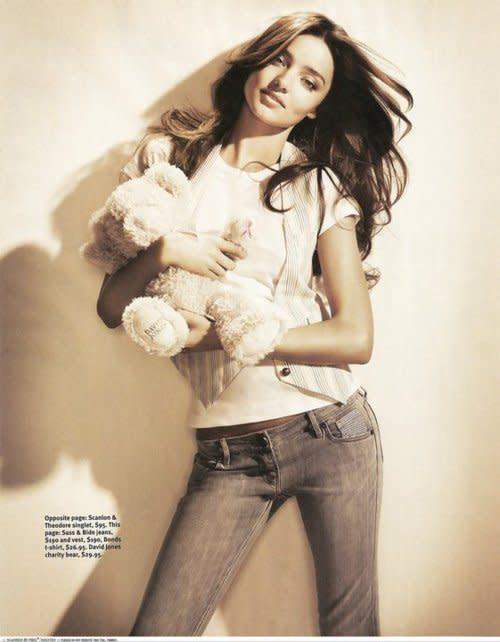 Miranda Kerr, grown woman, just hanging out in skin-tight jeans clutching her Bear-Bear.