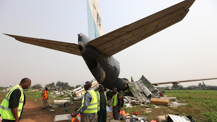 Workers dismantle an abandoned airplane at Murtala Muhammed International Airport in Lagos, Nigeria, Thursday, Jan. 31, 2013. Nigerian aviation officials have begun trying to dismantle and remove the hulks of abandoned aircrafts from airports around this nation with a history of aviation disasters. Officials say there are least 65 abandoned planes at the country's airports, with at least 13 at Lagos' international airport. (AP Photo/Sunday Alamba)