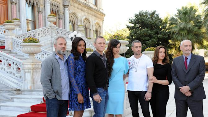 From left, director Sam Mendes, actors Naomie Harris, Daniel Craig, Berenice Marlohe, Ola Rapace, producers Barbara Broccoli, and Michael G. Wilson arrive for the photo call of the 23rd film in the James Bond series, 'Skyfall', in Istanbul, Turkey, Sunday, April 29, 2012. (AP Photo )