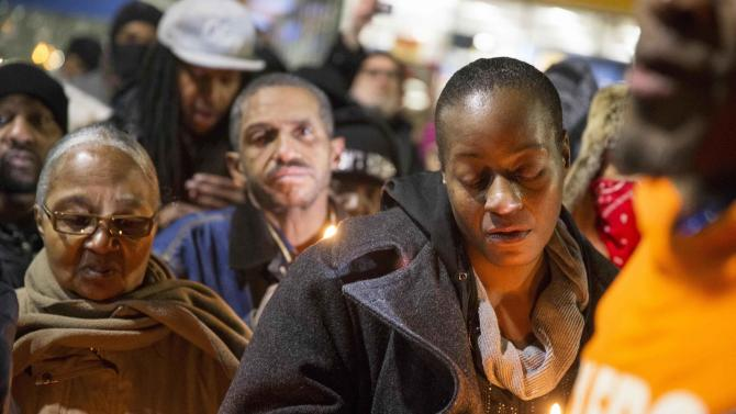 Toni Martin, mother of Antonio Martin, who was fatally shot, attends a prayer vigil in Berkeley, Missouri