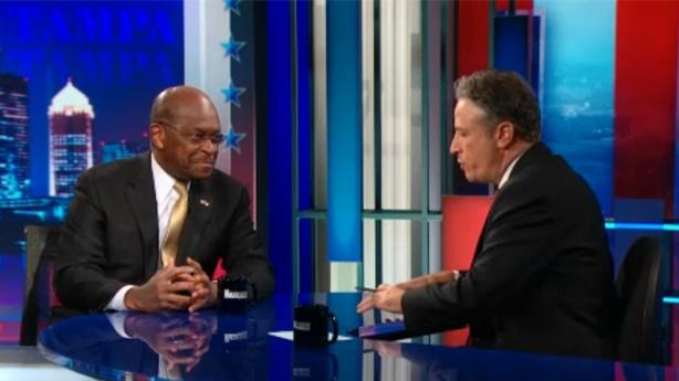 Herman Cain and His Big Personality Visits with Jon Stewart