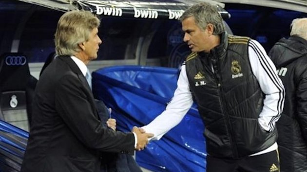 Manuel Pellegrini (L) shakes hand with Real Madrid&#39;s Portuguese coach Jose Mourinho