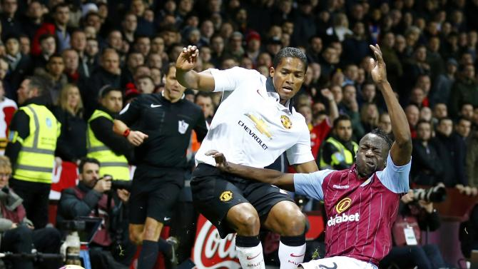 Manchester United's Luis Antonio Valencia challenges Aston Villa's Aly Cissokho during their English Premier League soccer match at Villa Park in Birmingham