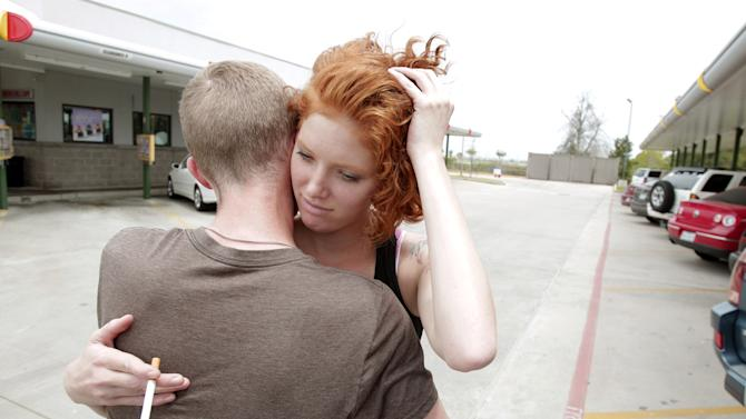 Cassie Foe hugs classmate Christian Wilson after leaving from the Cy-Fair campus of Lone Star Community College in Cypress, Texas,  where she witnessed a male getting stabbed on Tuesday, April 9, 2013.  More than a dozen people were wounded when a suspect went building-to-building in an apparent stabbing attack at the college campus authorities said.  The attack on the Lone Star Community College System's campus in Cypress sent at least 12 people to area hospitals, including four people taken by helicopter, according to Cy-Fair Volunteer Fire Department spokesman Robert Rasa.  (AP Photo/Houston Chronicle, Melissa Phillip)  MANDATORY CREDIT