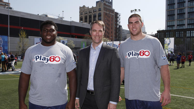IMAGE DISTRIBUTED FOR TIDE - Chris Lillich, Associate Marketing Director for Tide at Procter & Gamble, joined by top NFL Draft prospects Chance Warmack and Eric Fisher at the NFL PLAY 60 Youth Football Festival (YFF) event at Chelsea Waterside Park on Wednesday, April 24, 2013 in New York City. Tide, an official sponsor of the NFL, announced that they will offer endorsement deals to the first player drafted to each of the 32 NFL teams. On draft night, these players will ask fans to share what team colors mean to them by tweeting out using #AboutOurColors. (Amy Sussman/AP Images for Tide)