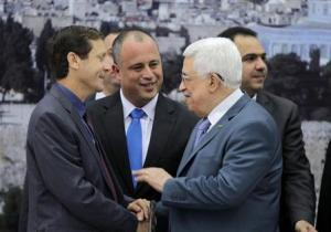 Israeli parliament members Herzog and Bar shake hands with Palestinian President Abbas as they attend a meeting in Ramallah