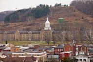In this Friday, Dec. 16, 2011 photo, the Trans-Allegheny Lunatic Asylum is shown in Weston, W.Va. The former psychiatric hospital is now being marketed as a historic and paranormal tourist attraction. (AP Photo/David Smith)