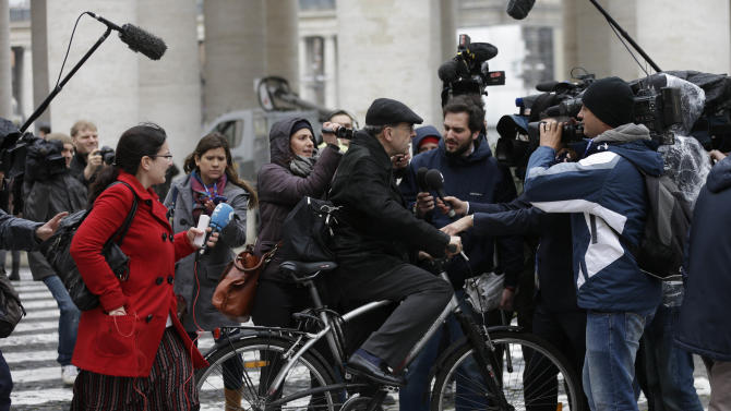 Cardinal Philippe Barbarin is surrounded by reporters after a cardinals' meeting, at the Vatican, Wednesday, March 6, 2013. Cardinals from around the world have gathered inside the Vatican for their first round of meetings before the conclave to elect the next pope, amid scandals inside and out of the Vatican and the continued reverberations of Benedict XVI's decision to retire. (AP Photo/Alessandra Tarantino)