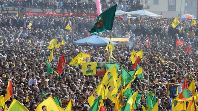 Some thousands of supporters demonstrate waving various PKK flags and images of jailed Kurdish rebel leader Abdullah Ocalan, in southeastern Turkish city of Diyarbakir, Turkey, Thursday, March 21, 2013, as Ocalan called Thursday for an immediate cease-fire and for thousands of his fighters to withdraw from Turkish territory, a major step toward ending the fighting for self-rule for Kurds in southeastern Turkey, one of the world's bloodiest insurgencies lasting nearly 30-years and costing tens of thousands of lives. (AP Photo)
