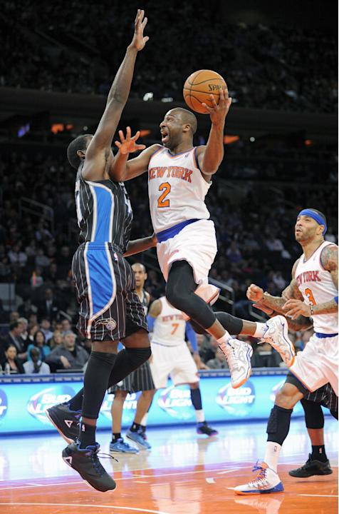 New York Knicks' Raymond Felton (2) goes up to shoot as Orlando Magic forward Andrew Nicholson defends during the second quarter of an NBA basketball game on Friday, Dec. 6, 2013, at Madison Squar