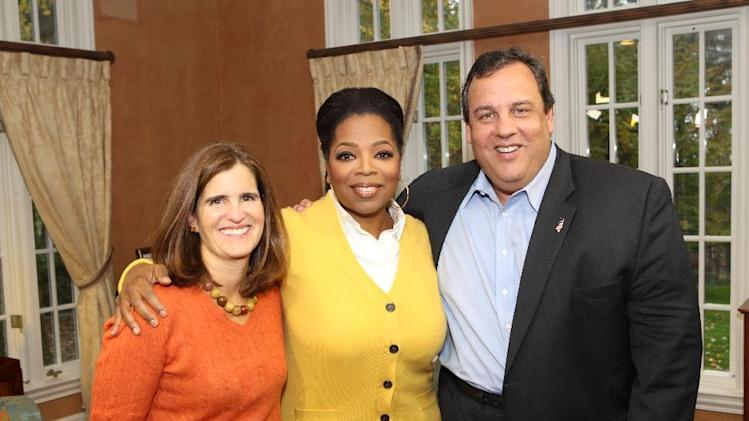 "In this Oct. 27, 2011 photo released by Harpo Inc., Oprah Winfrey, center, poses with New Jersey Gov. Chris Christie, right, and his wife Mary Pat during an interview at the Christie home in Mendham, N.J., for ""Oprah's Next Chapter"", airing Sunday, Jan. 15, 2012 on OWN.  (AP Photo/Harpo, Inc. George Burns)"