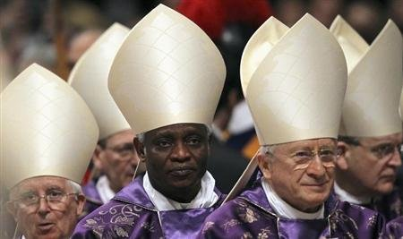 Cardinal Peter Turkson (2nd L) during the Ash Wednesday mass at the Vatican February 13, 2013. Thousands of people are expected to gather in the Vatican for Pope Benedict's Ash Wednesday mass, which is expected to be his last before leaving office at the end of February. REUTERS/ Alessandro Bianchi