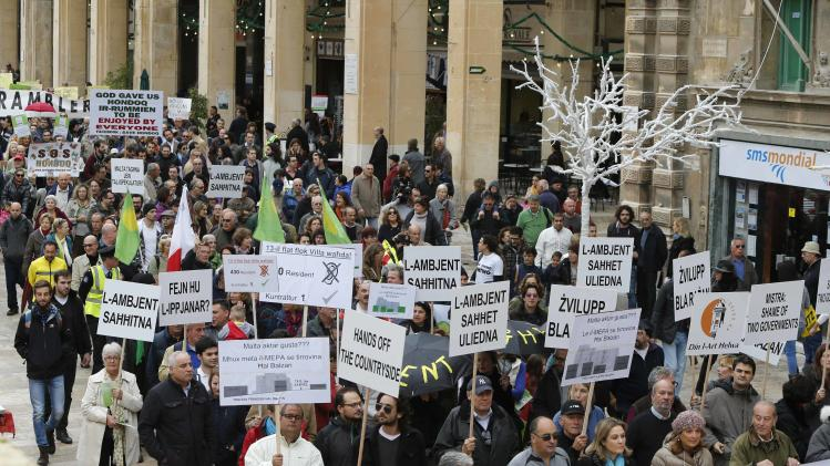 Protesters calling on the Maltese government to focus on tangible environmental measures instead of focusing solely on development march into Valletta