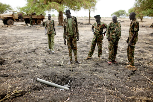 Sudan&lt;br /&gt;&lt;br /&gt;&lt;br /&gt;&lt;br /&gt;&lt;br /&gt;&lt;br /&gt;&lt;br /&gt;&lt;br /&gt;&lt;br /&gt;<br />  People's Liberation Army (SPLA) soldiers inspect ordinance dropped by the Sudan Armed Forces (SAF) at a frontline position in Pana Kuach, Unity State, South Sudan. SAF forces regularly employ air strikes, a capability that southern forces lack. In late April, tensions between Sudan and South Sudan erupted into armed conflict along their poorly defined border. Thousands of SPLA forces have been deployed to Unity State where the two armies are at a tense stalemate around the state's expansive oil fields. Fighting between the armies lulled in early May after the U.N. Security Council ordered the countries to resume negotiations. South Sudan seceded from the Republic of Sudan in July 2011 following decades of civil war. (AP Photo/Pete Muller)