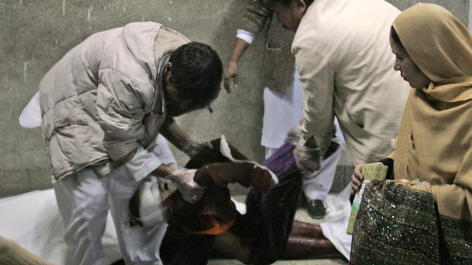 Pakistani volunteers carry the lifeless body of a girl, who was killed in a bomb blast, at a hospital in Quetta, Pakistan, Saturday, Feb. 16, 2013. A bomb ripped through a crowded vegetable market in a mostly Shiite neighborhood in a southern Pakistani city Saturday, killing scores of people in a horrific attack on the country's minority Muslim sect. (AP Photo/Arshad Butt)
