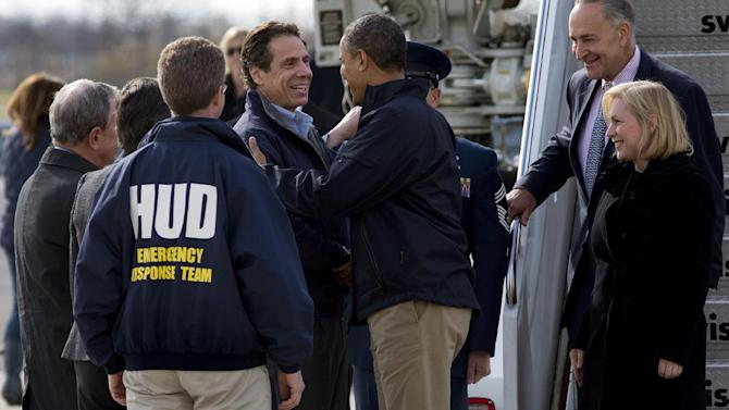 President Barack Obama is greeted by New York Gov. Andrew Cuomo upon his arrival at JFK International Airport in New York Thursday, Nov. 15, 2012, before taking a aerial tour of damage along the New York coastline in the of Superstorm Sandy. From left are, New York City Mayor Michael Bloomberg, Housing and Urban Development Secretary Shaun Donovan, in HUD jacket, Cuomo, the president, Sen. Kirsten Gillibrand, D-N.Y., and Sen. Charles Schumer, D-N.Y. (AP Photo/Craig Ruttle)