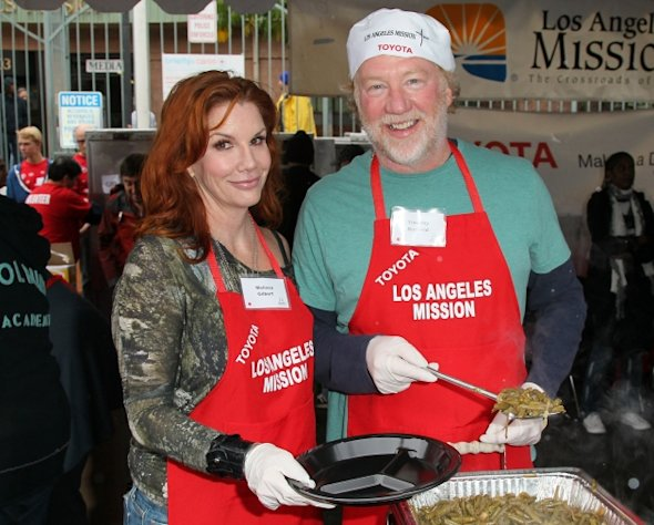 Melissa Gilbert and Timothy Busfield attend the Los Angeles Mission&#39;s Christmas Eve for the homeless at the Los Angeles Mission on December 24, 2012 in Los Angeles, California