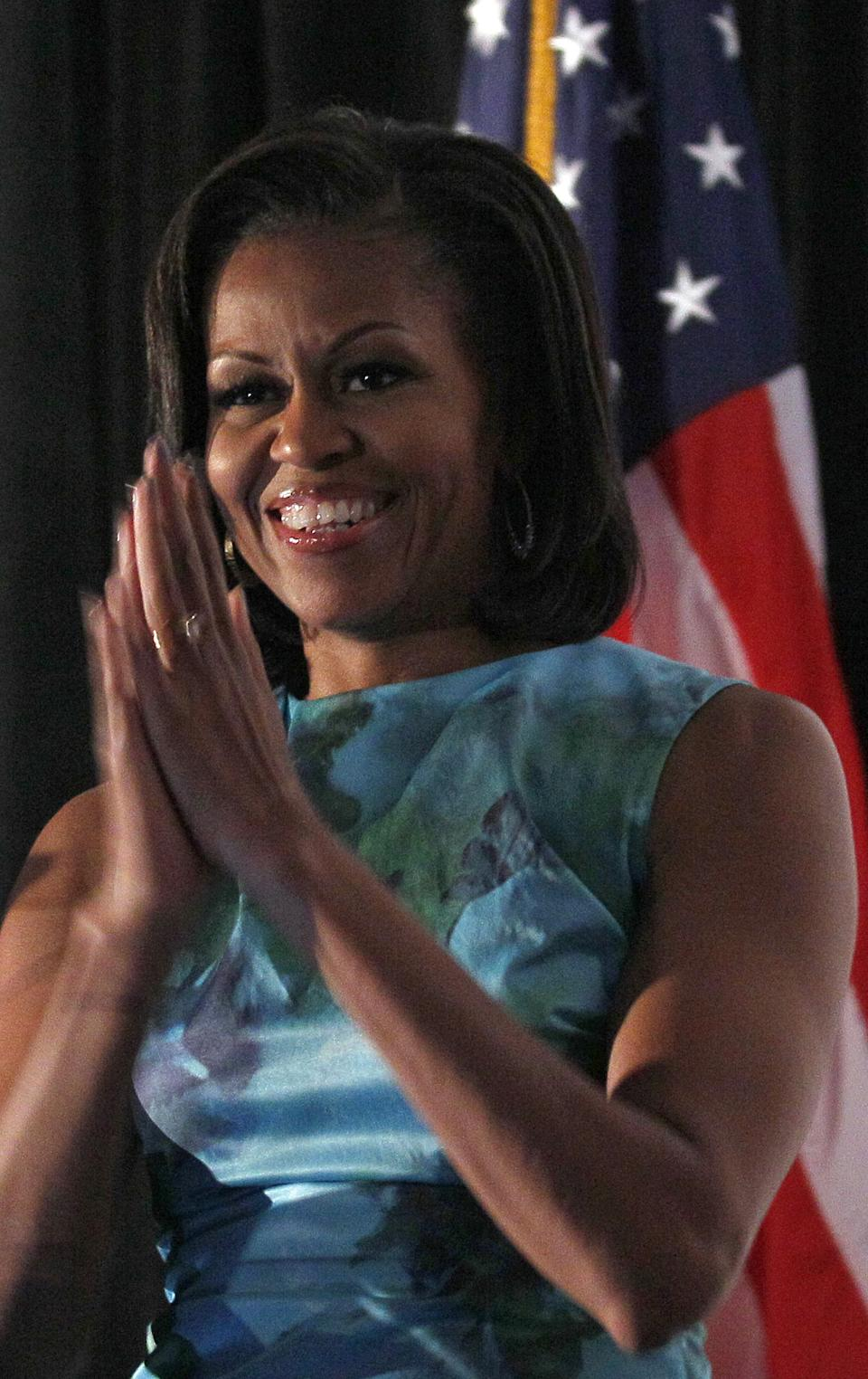 First lady Michelle Obama applauds while speaking during a Human Rights Campaign luncheon while attending the Democratic National Convention in Charlotte, N.C., Wednesday, Sept. 5, 2012. (AP Photo/Gerry Broome)