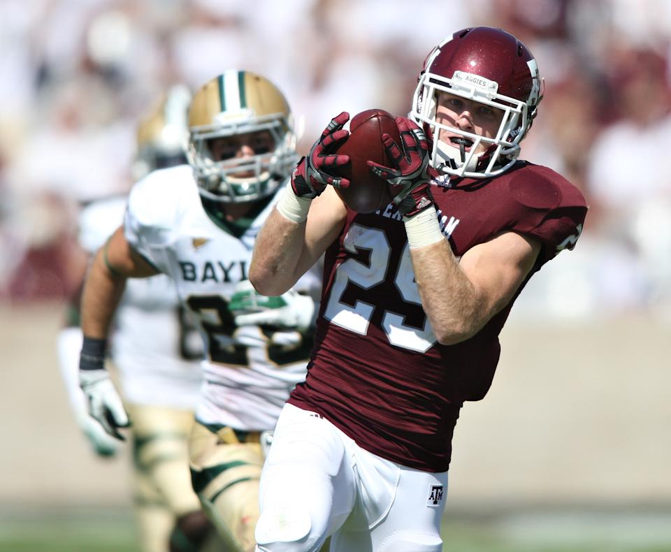 Texas A&M's Ryan Swope, right, outruns Baylor's Sam Holl, left, during the first half of an NCAA college football game Saturday, Oct. 15, 2011, in College Station, Texas. Swope scored on the play.  (AP Photo/Jon Eilts)