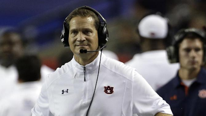 Auburn Coach Gene Chizik reacts after a Clemson score in the second quarter of a NCAA college football game at the Georgia Dome in Atlanta Saturday, Sept. 1, 2012. (AP Photo/Dave Martin)