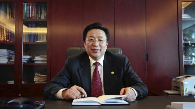 Sun Zhaoxue, then-president of China National Gold Group Corp, poses for a photo in his office in Beijing