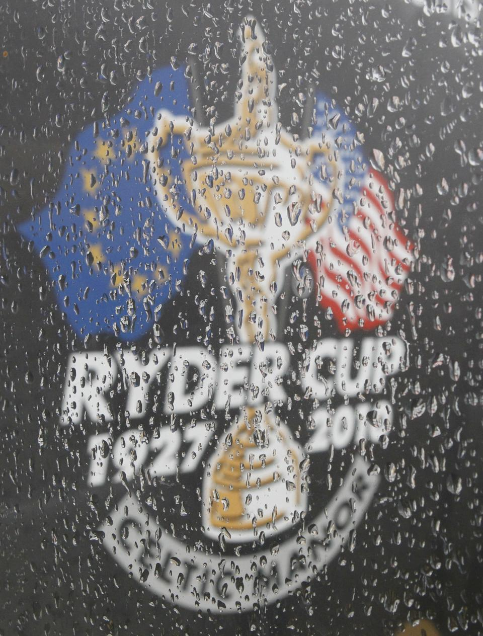 A Ryder Cup logo is seen through a window covered in raindrops during a heavy rainfall that suspended play at the 2010 Ryder Cup golf tournament at the Celtic Manor golf course in Newport, Wales, Friday, Oct.  1, 2010. (AP Photo/Peter Morrison)