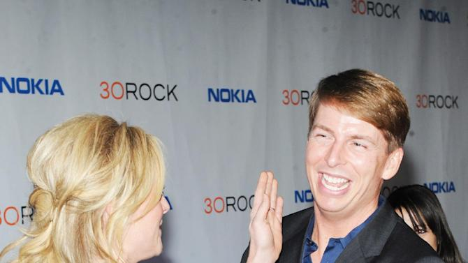 "IMAGE DISTRIBUTED FOR NOKIA - Jane Krakowski, left, and Jack McBrayer attend the Nokia ""30 Rock"" wrap party on Thursday, Dec. 20, 2012 in New York. (Photo by Scott Gries/Invision for Nokia/AP Images)"