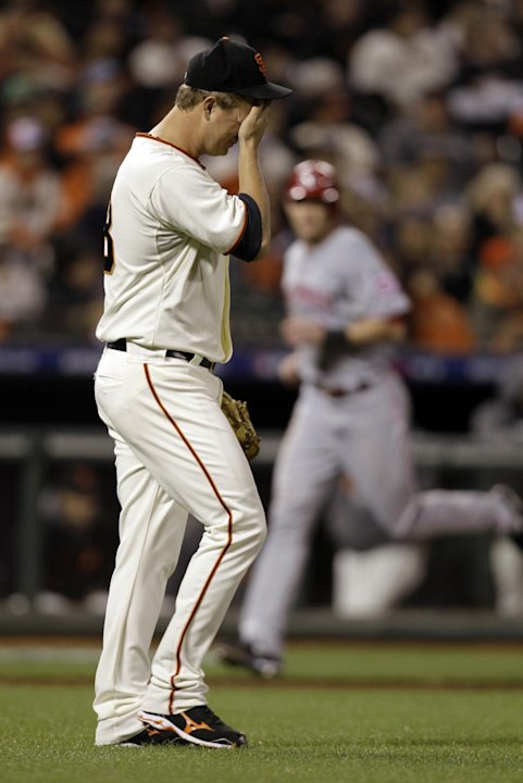 San Francisco Giants pitcher Matt Cain reacts after giving up a two-run home home to Cincinnati Reds' Brandon Phillips in the third inning of Game 1 of the National League division baseball series in