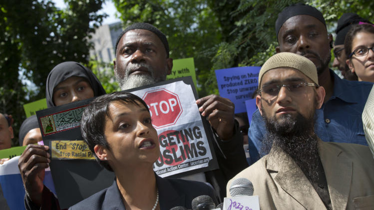 Hina Shamsi, left, director of the ACLU's National Security Project, addresses the media on a plaza in front of New York City Police Department headquarters, Tuesday, June 18, 2013. In a lawsuit filed Tuesday, civil rights lawyers urged a U.S. judge to declare the NYPD's widespread spying programs directed at Muslims to be unconstitutional, order police to stop their surveillance and destroy any records in police files.(AP Photo/Richard Drew)