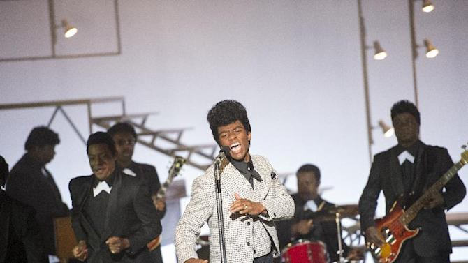 """This image released by Universal Pictures shows Chadwick Boseman in a scene from """"Get On Up."""" (AP Photo/Universal Pictures)"""